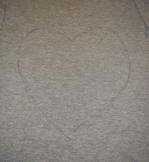 Refashion a T-Shirt with a Heart Cut Out for Valentine's Day - Refashion / upcycle those t-shirts with a a few snips and lace for the day of love. Step-by-step DIY sewing tutorial for upcycling clothes into some other type of clothing or accessory. Remake, redo, reuse, and recycle to help save money and save the planet. Explore the web site for more refashioning tutorials, dozens of cute refashionista and fashion ideas with good, clear photos and instructions. http://letgoofbeingperfect.com/