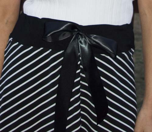 Satin Bow Skirt Refashion - Refashion / upcycle a skirt with a bow on the front! Find any solid or pattern skirt and add a ribbon bow on the waist. Step-by-step DIY sewing tutorial for upcycling clothes into some other type of clothing or accessory. Remake, redo, reuse, and recycle to help save money and save the planet. Explore the web site for more refashioning tutorials, dozens of cute refashionista and fashion ideas with good, clear photos and instructions. http://letgoofbeingperfect.com/