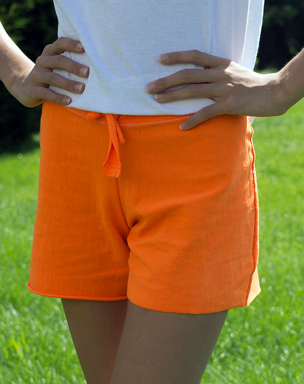 DIY Refashion Jersey Shorts from a Man's T-Shirt - Refashion / upcycle a man's #tshirt into a pair of workout or lounge shorts, with no pattern needed. Step-by-step DIY sewing tutorial for upcycling clothes into a a custom pair of shorts. Remake, redo, reuse, and recycle to help save money and save the planet. Explore the web site for more refashioning tutorials, dozens of cute refashionista and fashion ideas with good, clear photos and instructions. http://letgoofbeingperfect.com/